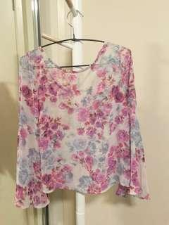 Floral top with bell sleeves