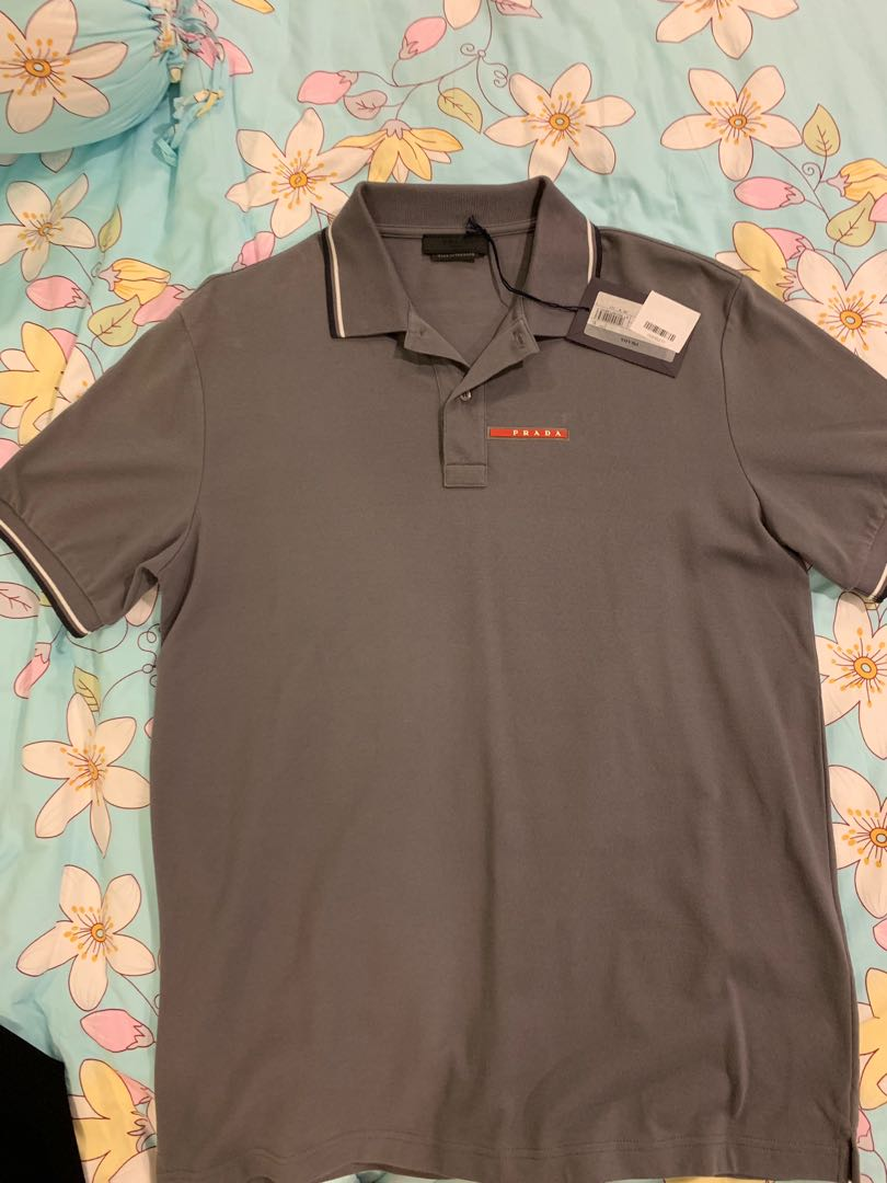 a8d2777c3 Grey Prada polo tee, Men's Fashion, Clothes, Tops on Carousell