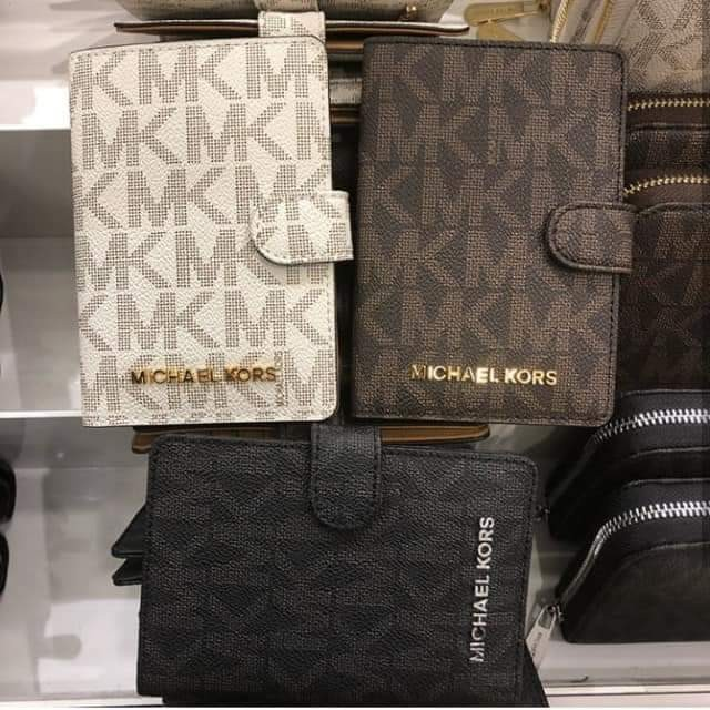 debbe60d2bb Michael Kors Passport Holder, Luxury, Bags & Wallets, Others on Carousell