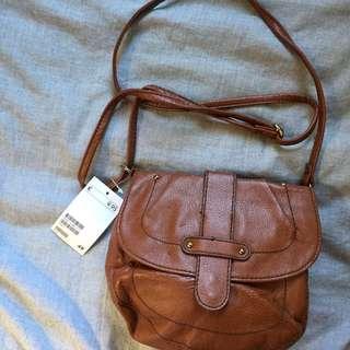 NEW tan strap bag