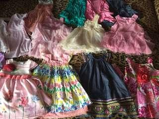 Lots of girls clothes. Dress, hat, pants, shorts, tops and more. All size 1-2 years old