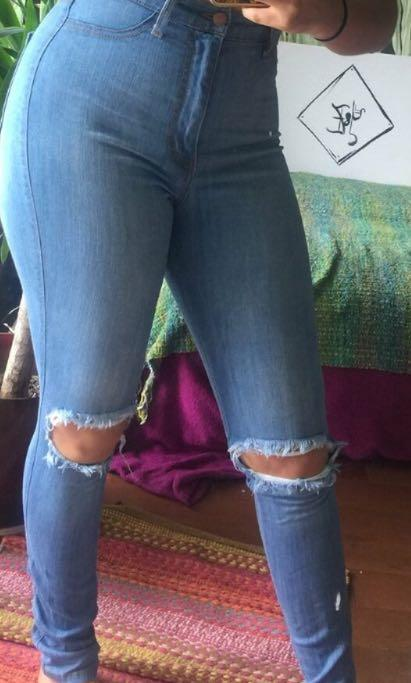 High waisted jeans with holes in knees from Fashion Nova!