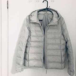 Light grey uniqlo ultra light seamless down jacket