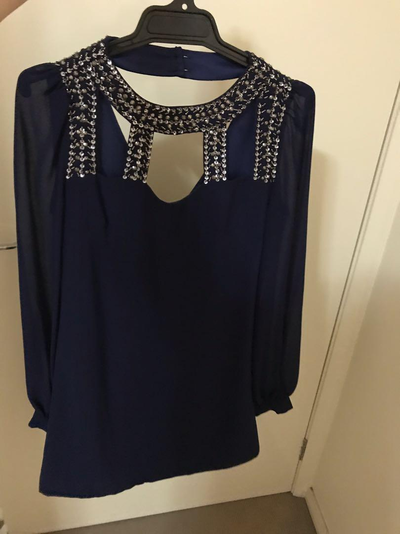 Long sleeve navy dress with high neck and embellished detail