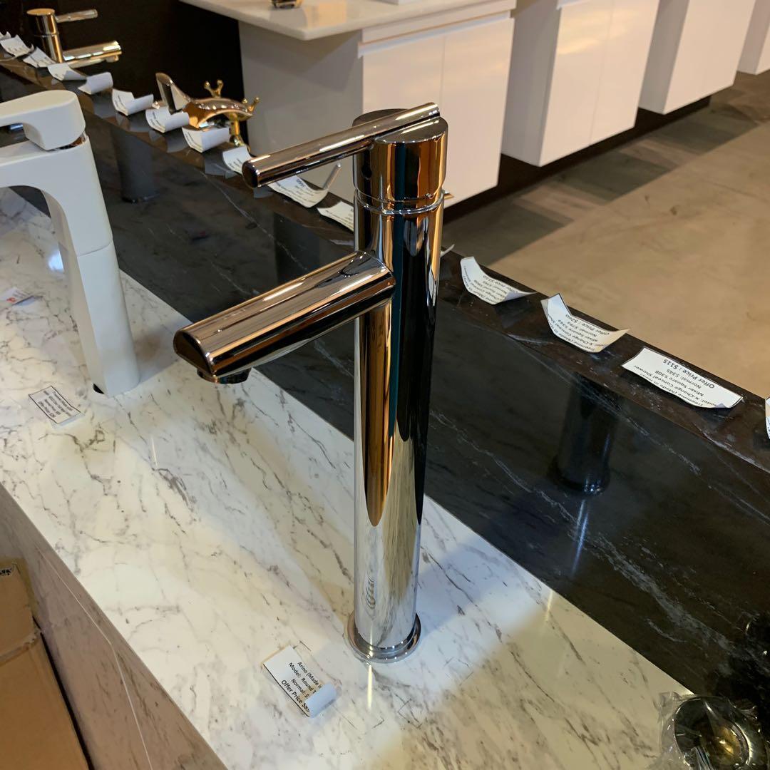 Tall basin mixer tap