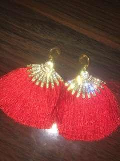 Red tassel earrings from nepal
