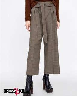 Brown houndstooth pleated trousers