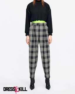 Black plaid pleated trousers