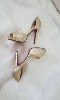 Authentic Christian Louboutin gold heels