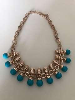 Necklace (some black spots found on blue ball area)