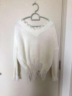 White knitted ripped sweater