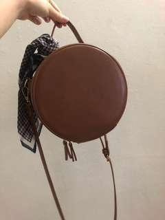 Brown round sling bag