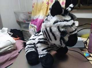 Zebra plush with beautiful blue eyes