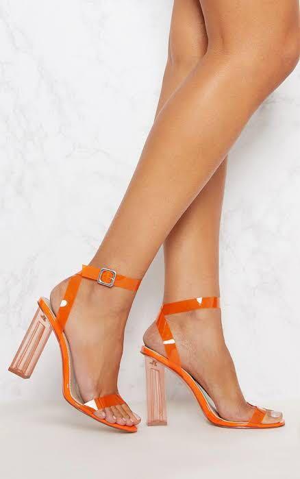 Orange clear heels + black thigh high boots