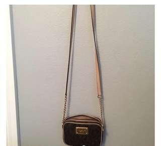 Michael kors small or purse /bag can be cross body