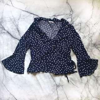 Spotted navy frill top size 6