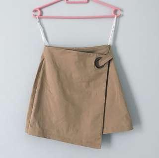 beige/ brown skirt