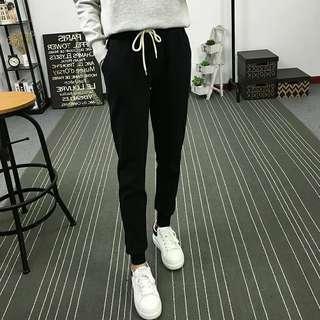 🚚 休閒長褲新款韓版學生運動鬆緊腰繫帶素 色小腳哈倫褲加大尺碼女生衣著.