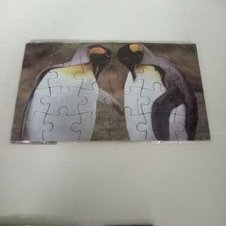 puzzle pinguin and dog