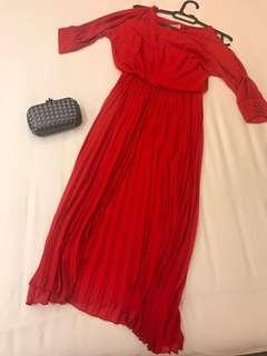 Red dress with pleated skirt and cut out shoulder