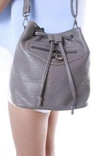 Grey tassel drawstring bag