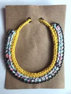 Social goods co-op twisted Celine yellow + multiflower with gold and brass necklace