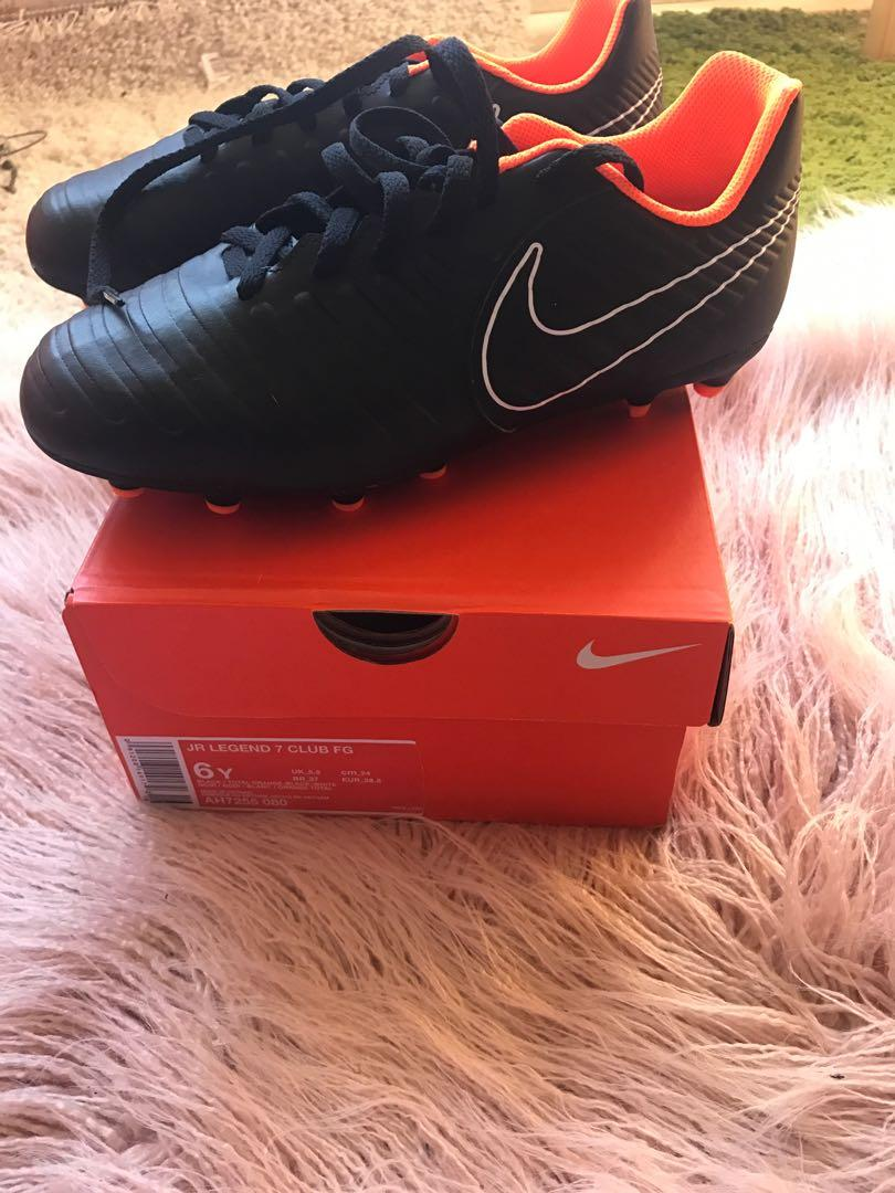 Soccer/Football boots & Nike shin guards NEVER BEEN USED