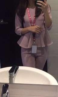 Pink peplum suit