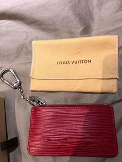 Louis Vuitton leather coin punch with key chain