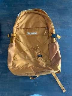 Gold Cordura Supreme backpack. 8/10, used.