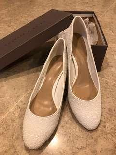 White heels by Charles & Keith
