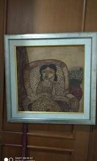 Lukisan perempuan duduk