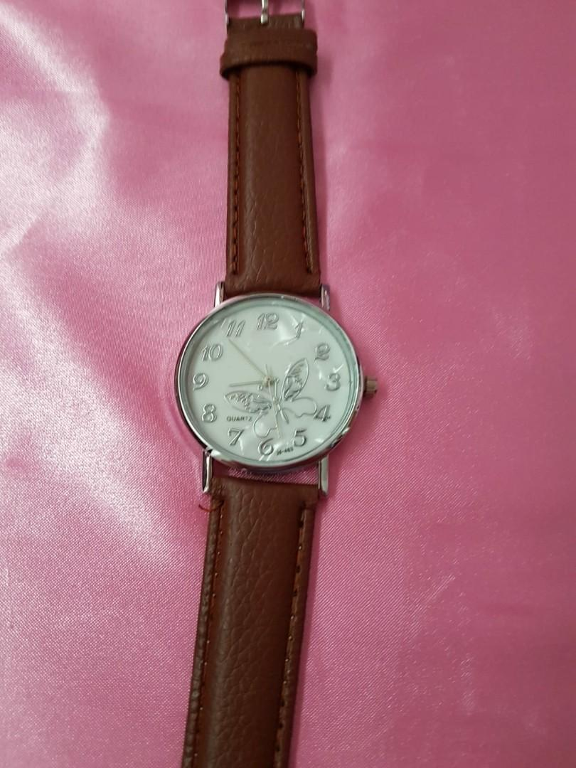 Brown strap watch for female only