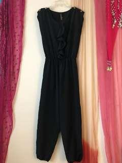 Chic Black Jumpsuit with Brass Seashell Buttons (size small)