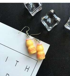 🚚 Yakult earrings (2 available)