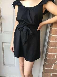 Black dress with shoulder frills