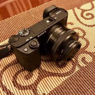 Sony A6300 with 16-50mm lens + 2 extra batteries