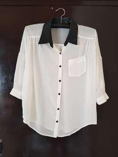 White top with faux leather collar