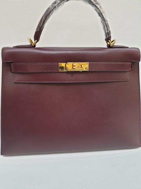 f7704e7036 Hermes Kelly 32 prune ghw F in box leather double ring