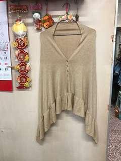 Women's knitted lurex cape