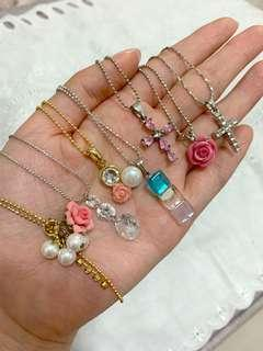 Crystal and flower pendants and necklaces