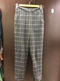 🚚 GU 格紋窄管褲