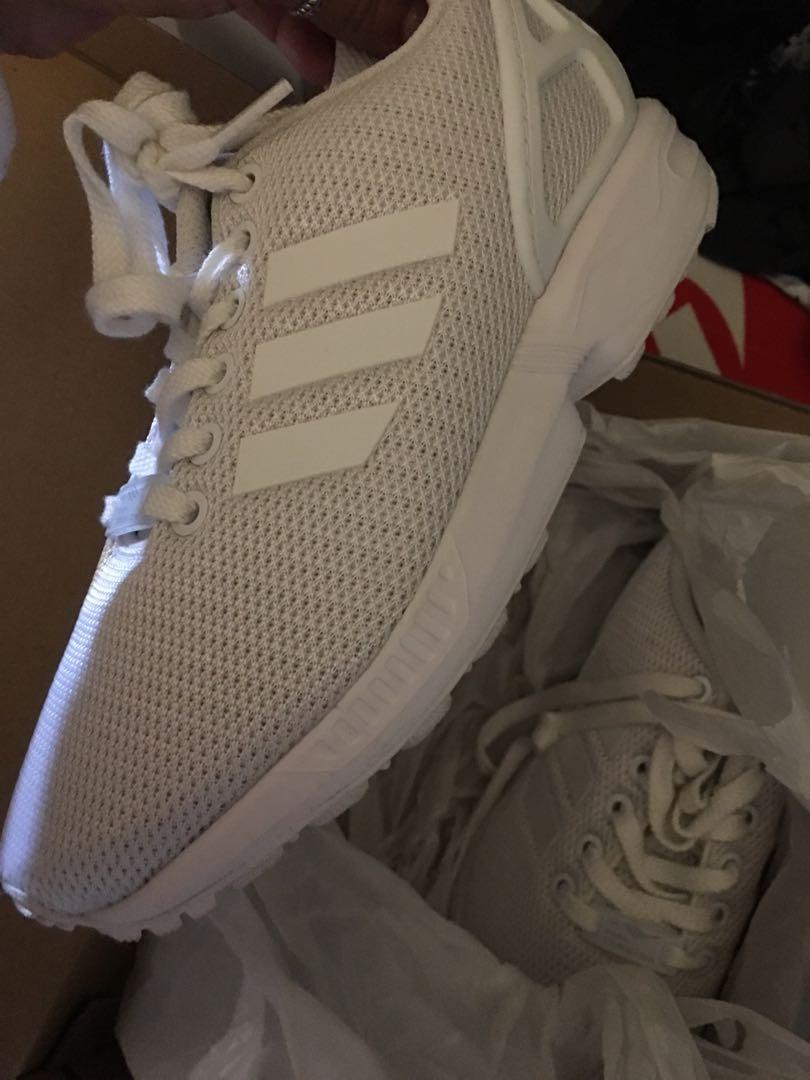 Addidas flux size 4 kids worn once only for few hours  didn't like them bought for 119 selling for 80 happy to also post with tracking on my expense