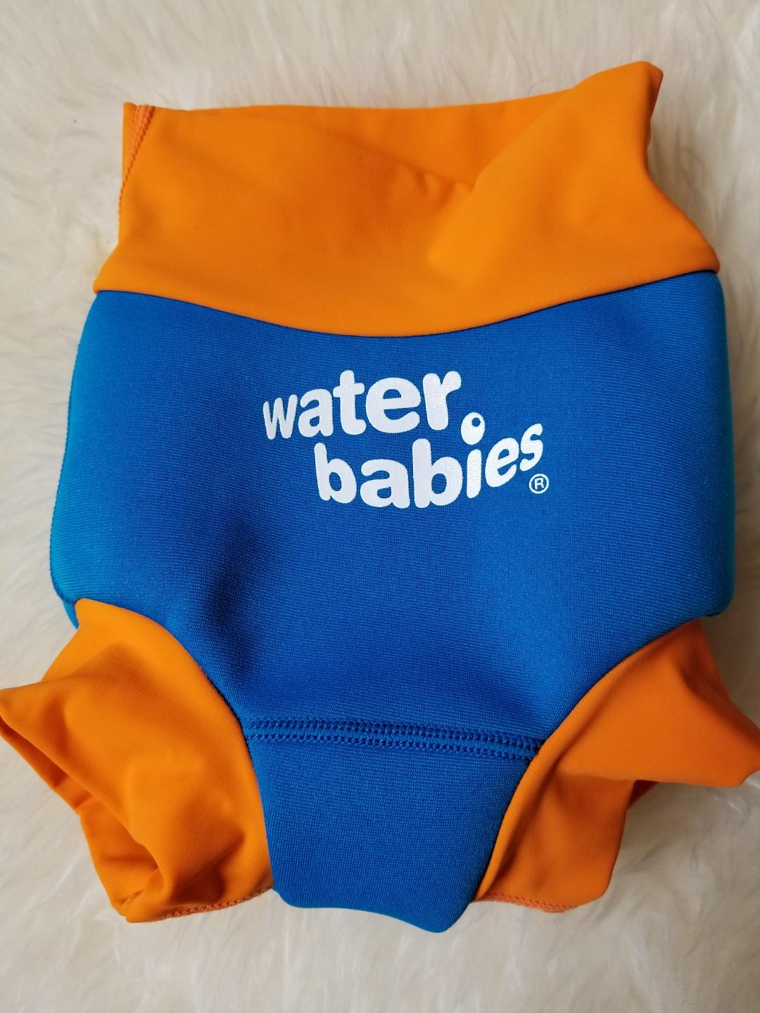 Water babies new happy nappy swim diaper size large. Fits 20 to 30lb. New condition. Pick up Gerrard and Main for $14 or Yorkville for $15. Purchased brand new for $28.