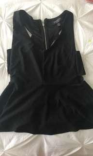 Black v neck top. Cut outs on the side