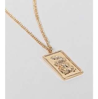 Tag necklace with dragon pendant in gold