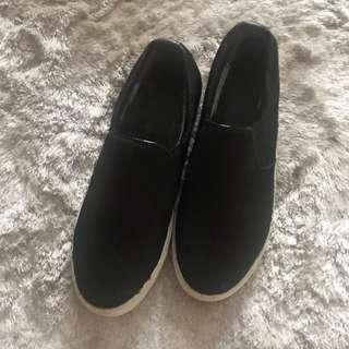 Black furry slip on shoes