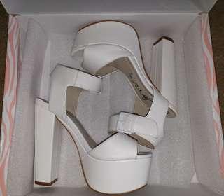 Betts white heels