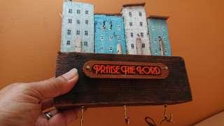 A Miniature House key Holder with wordings
