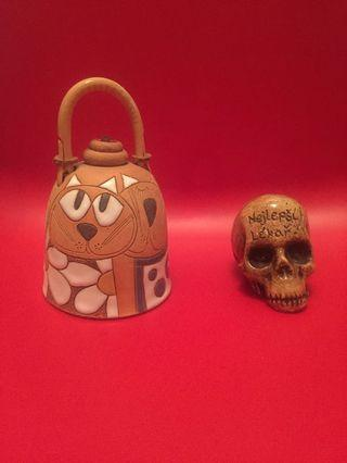 Skull and bell ornament